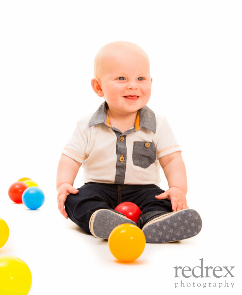 baby playing with colourful balls