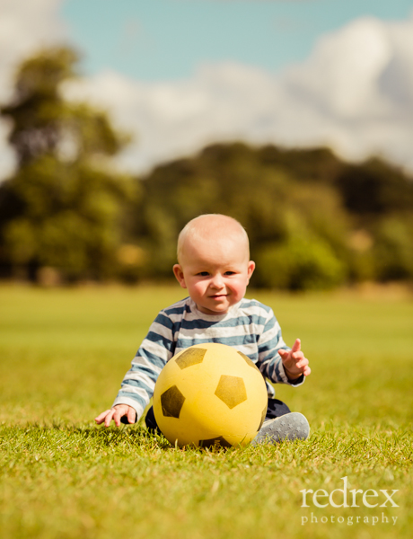 Baby with football in the park